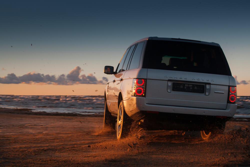SUV On The Beach