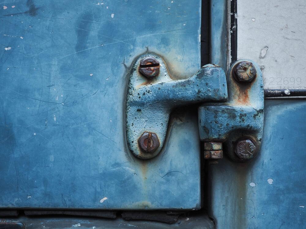 Rusty blue car door hinge - why your SUV squeaks