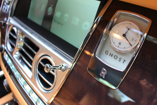 Analog CLock On A Luxury Car Dashboard
