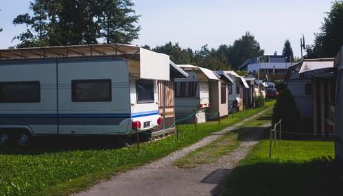white RVs under tents