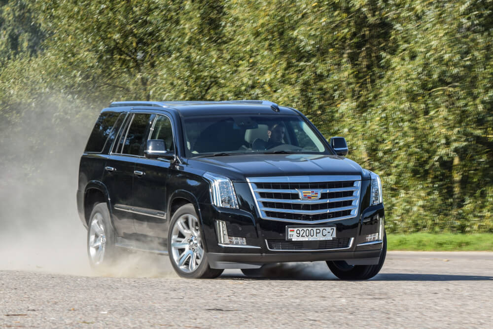Full-size, black Cadillac Escalade SUV - pros and cons of heavier cars