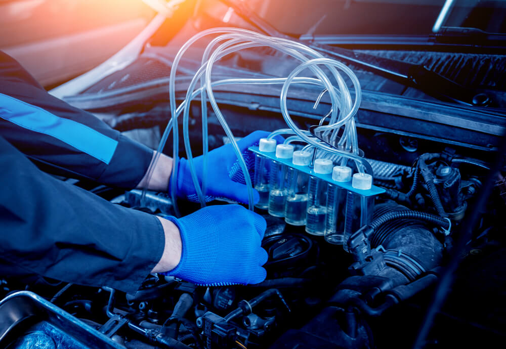 Cleaning engine injectors. Car repair. Service station - luxury cars bad mileage