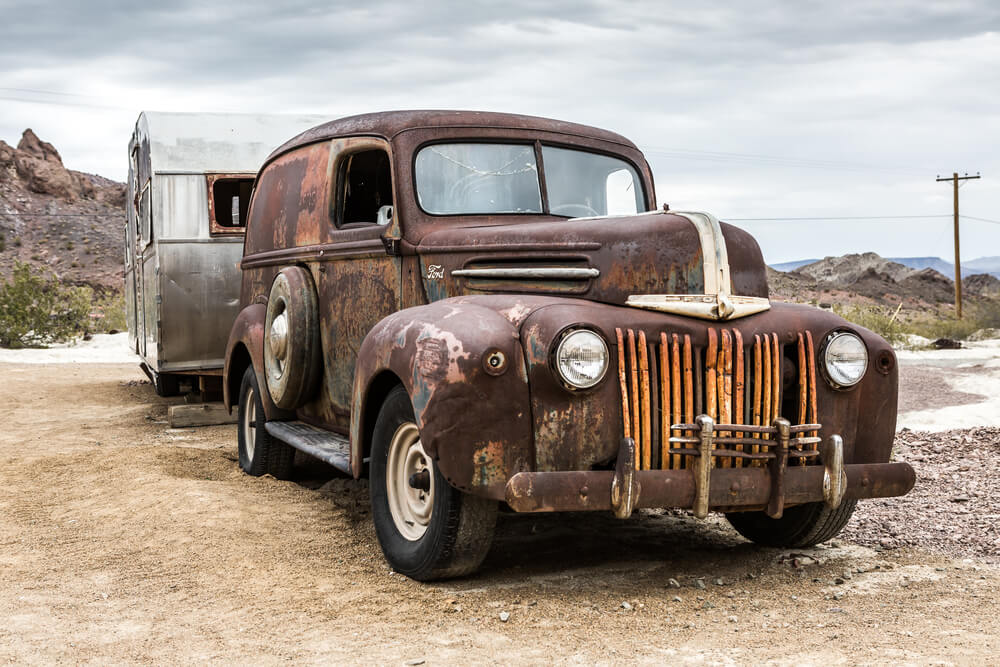 Vintage pickup truck with fading paint and rust - pickup trucks rust