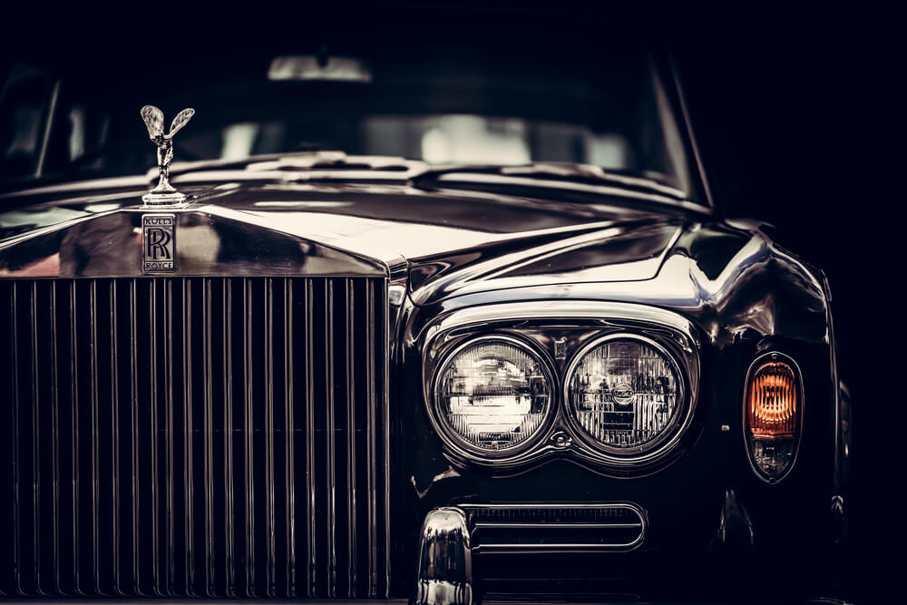classic British car on black background, close-up. - luxury cars rear-wheel drives