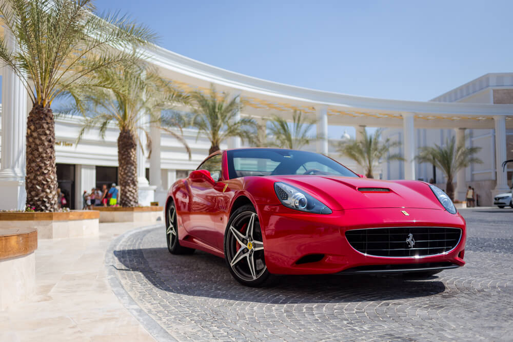 A red luxury Ferrari supercar. - luxury cars rear-wheel drives