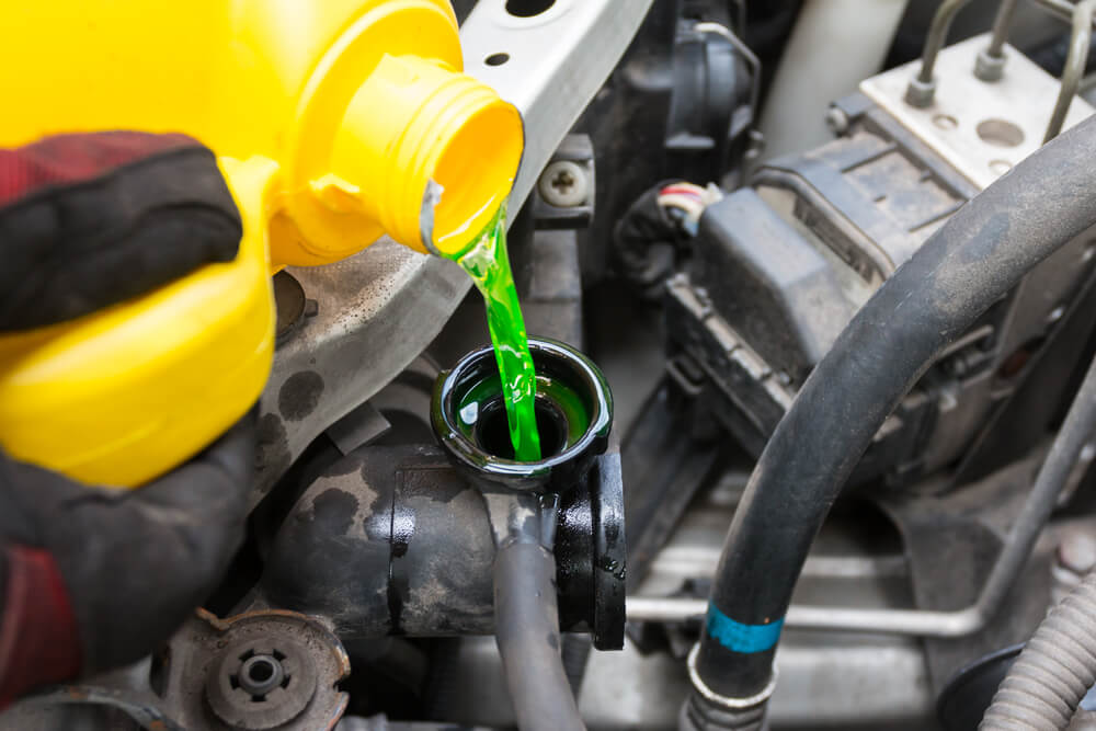 Pouring Coolant Into The System