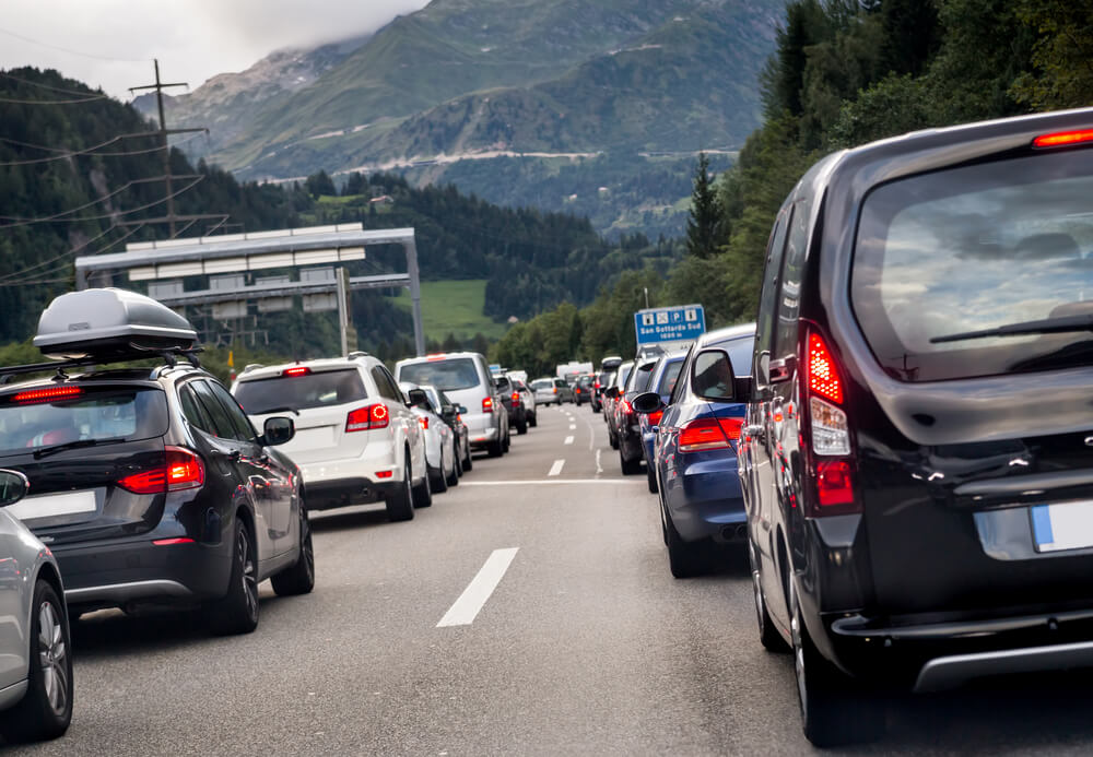 Transportation. pollution, cars, rush hour, vacation, travel and holiday concept. Sitting in traffic on a highway in Switzerland driving home to Lucern.